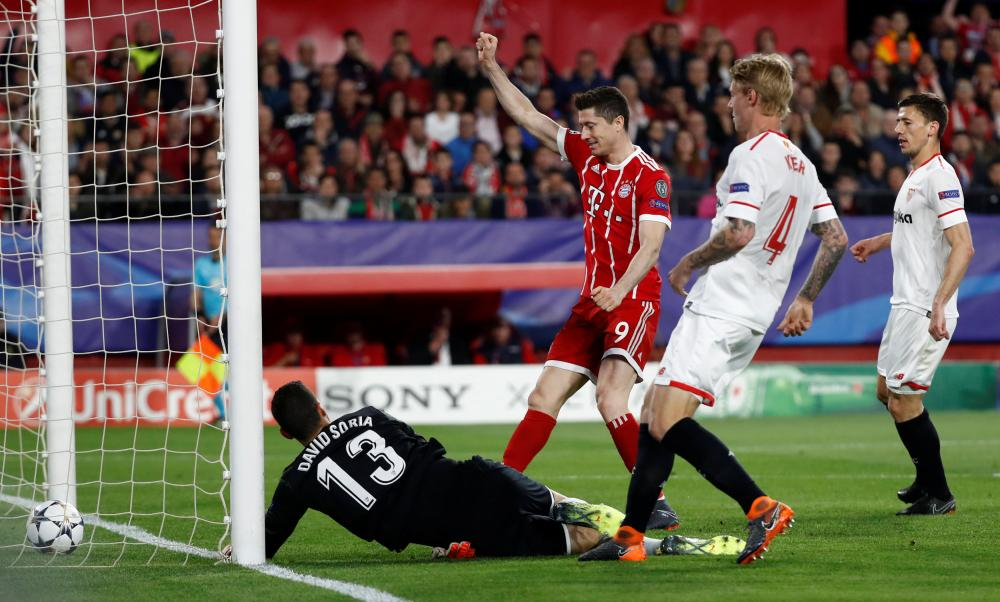 Robert Lewandowski celebrates after Soria fails to keep the ball from crossing the line.