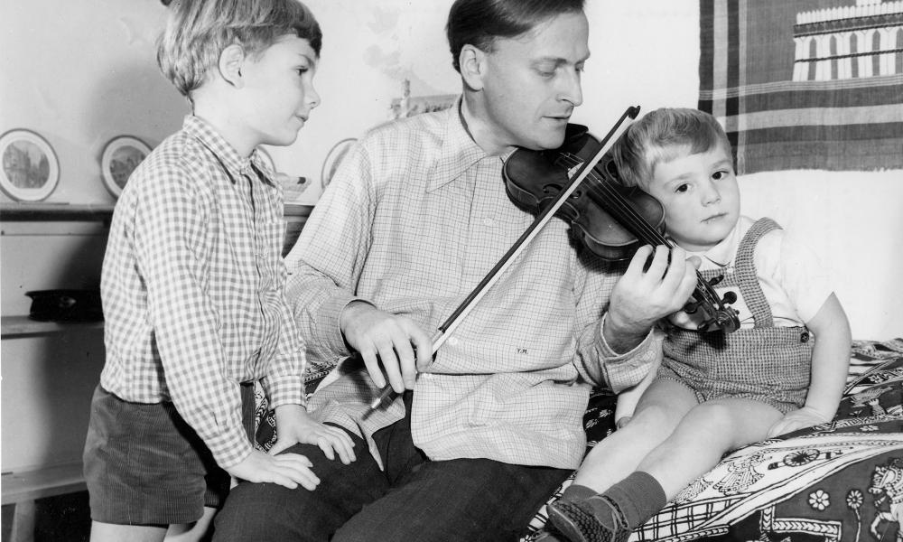 Yehudi Menuhin in 1954 with his sons. He made his first public appearance aged seven as solo violinist with the San Francisco Symphony Orchestra.