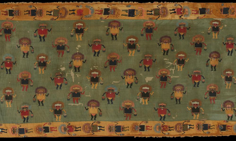 A detail from the 2,000-year-old funerary blanket showing human figures holding severed heads.