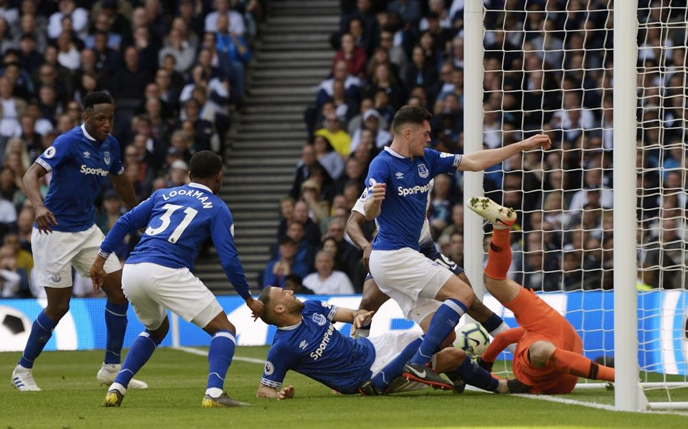 Tosun pokes in to score Everton's second.
