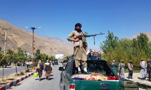 Taliban members on patrol after they took over Panjshir valley.