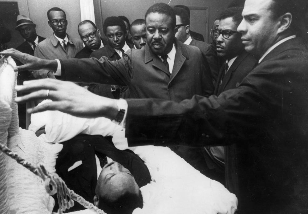 Mourners, including Ralph Abernathy, centre, and Andrew Young, right, pay their respects as Martin Luther King lies in state in Memphis, Tennessee.