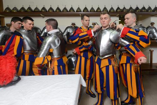 Pontifical Swiss Guards prepare for a swearing-in ceremony at the Vatican for recruits. Apart from ceremonial duties, their main role is to protect the pope
