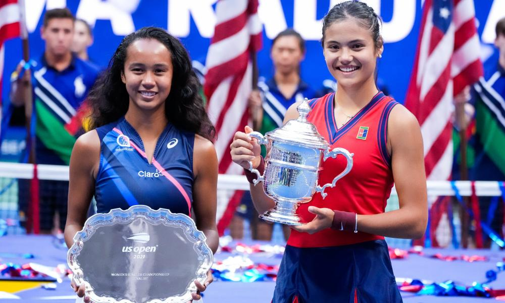Leylah Fernandez and Emma Raducanu with their trophies at the end of the match