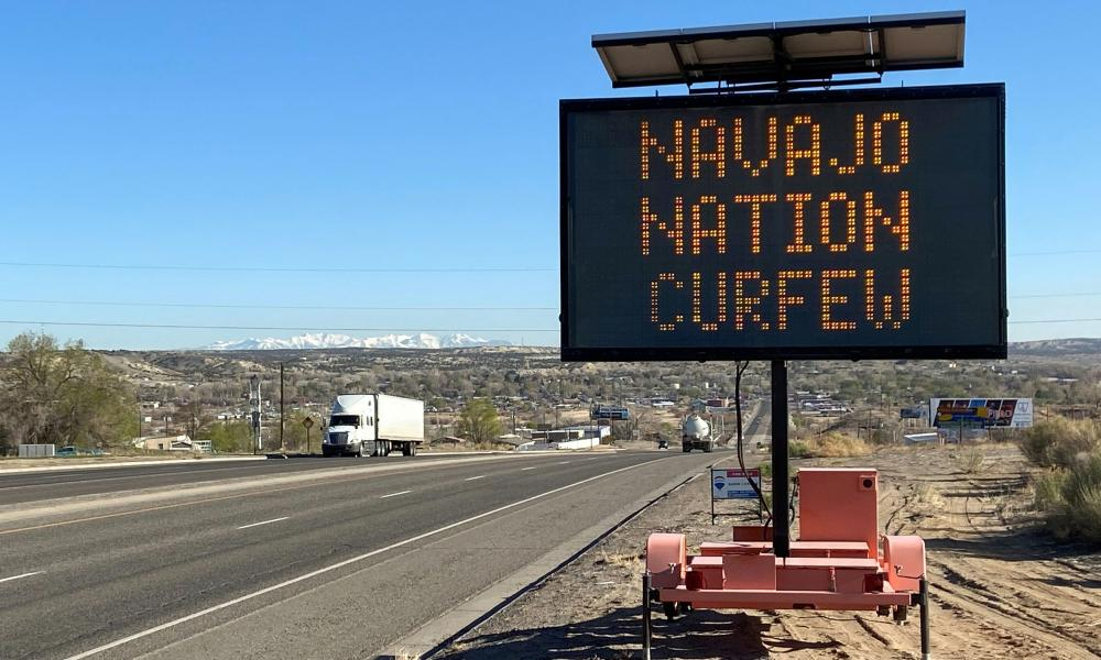 A road sign outside Bloomfield warns Navajos to stay home during their nation's 8pm to 5am curfew to slow the spread of coronavirus in New Mexico, US, 7 April 2020.