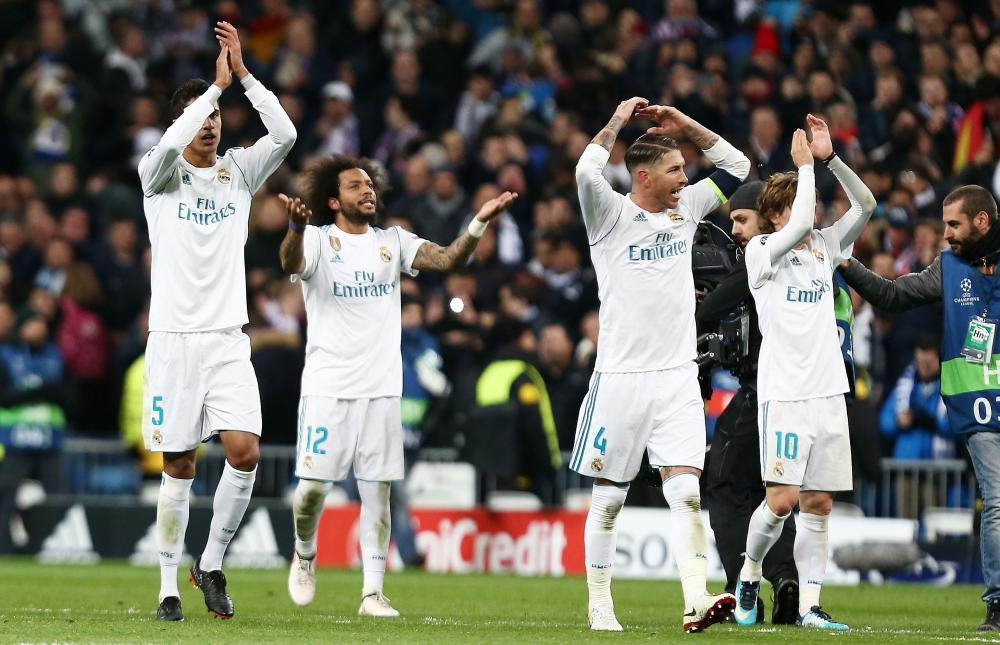 Real Madrid celebrate at full time.