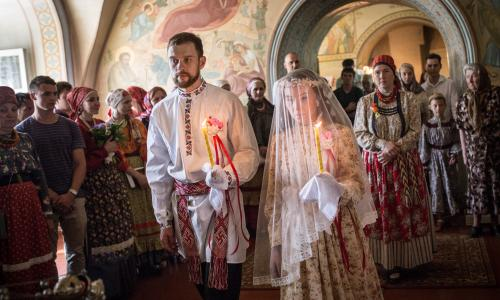 Bride Diana Khamitova and groom Ilya Klinkin during a wedding ceremony held according to an old Russian tradition, at the Resurrection Cathedral. The ceremony is organised as part of the work of the laboratory for social and anthropological research of the Tomsk State University