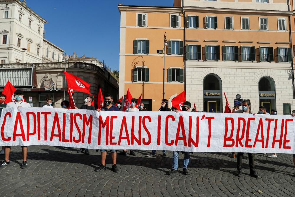 People protest in Rome on Friday in solidarity with George Floyd and protesters in the US.
