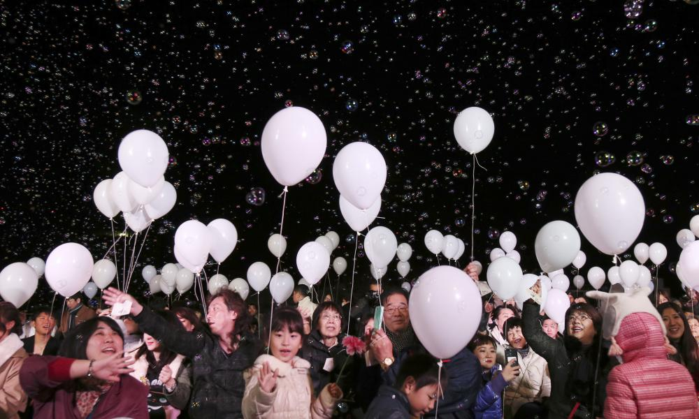 Balloons float over visitors during a New Year's Eve celebration at a Tokyo hotel.