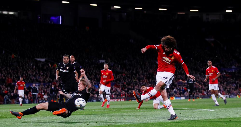 Fellaini shoots.