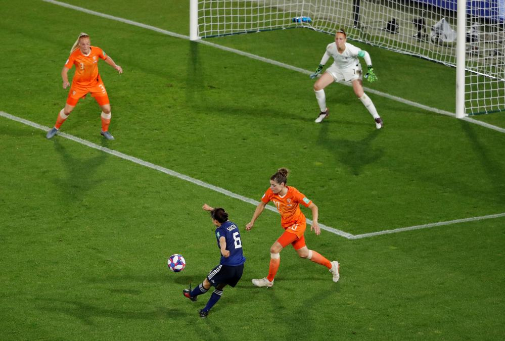 Japan's Hina Sugita shoots at goal, but is thwarted by the woodwork.