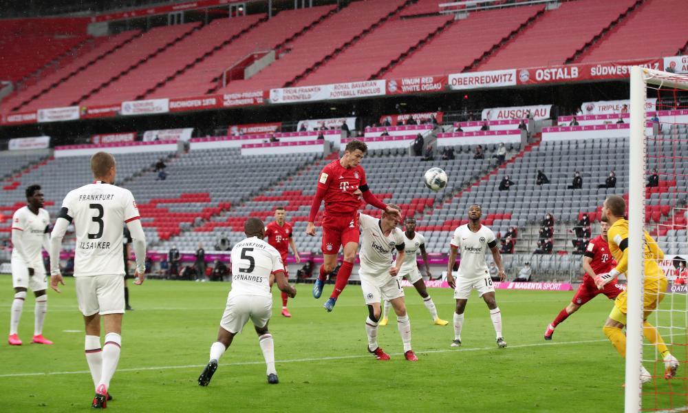 Benjamin Pavard of Bayern Munich heads the ball towards goal.