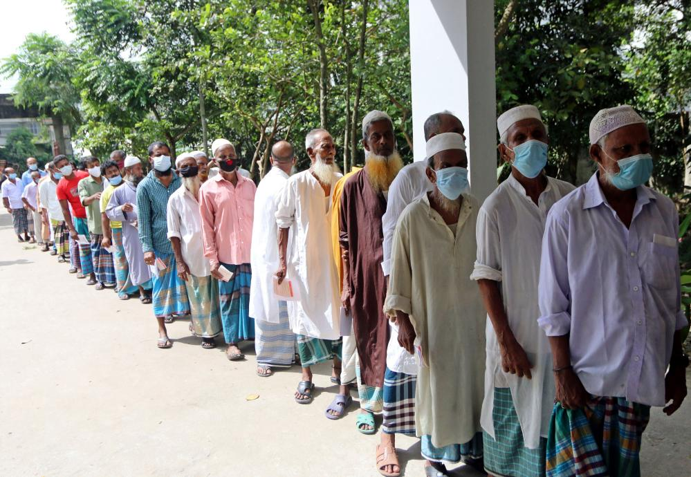 People queue to get their second doses during a mass vaccination campaign against Covid-19 in Chandpur, Bangladesh.