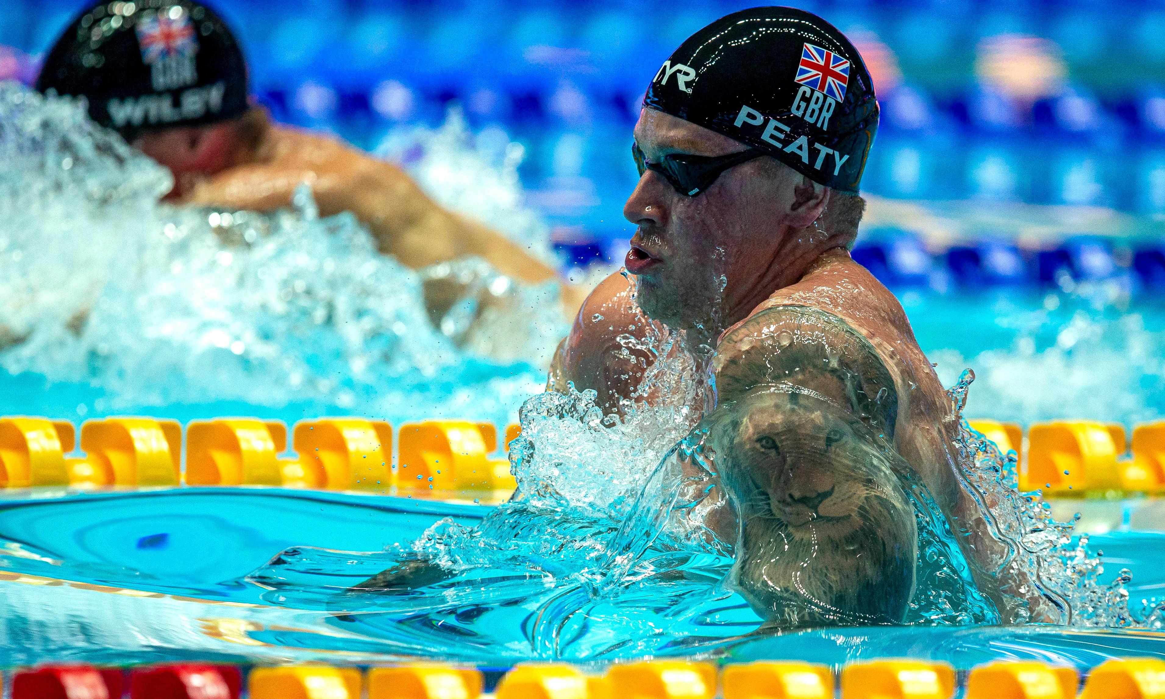 Adam Peaty wins 100m breaststroke gold at world championships