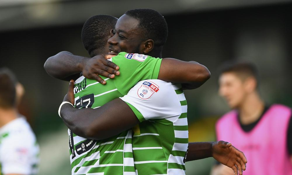 Francois Zoko and Olufela Olomola of Yeovil Town hug at the final whistle.