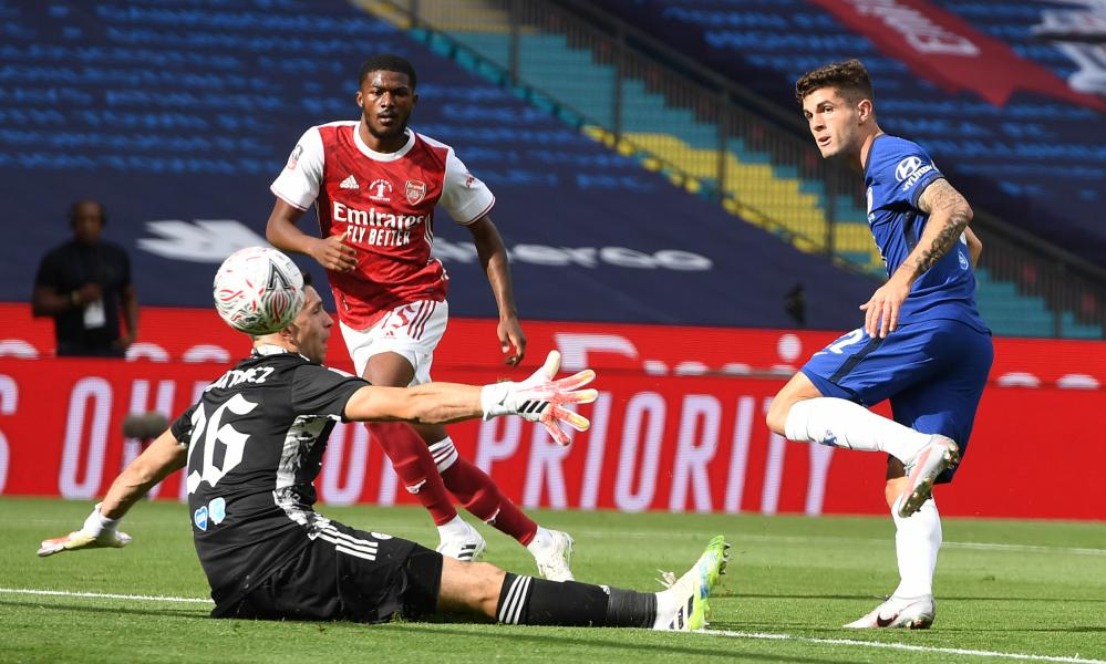 Chelsea's Christian Pulisic (right) scores the opening goal past Arsenal lkeeper Emiliano Martinez.