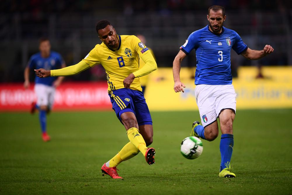 Thelin is tracked by Giorgio Chiellini as Sweden break.