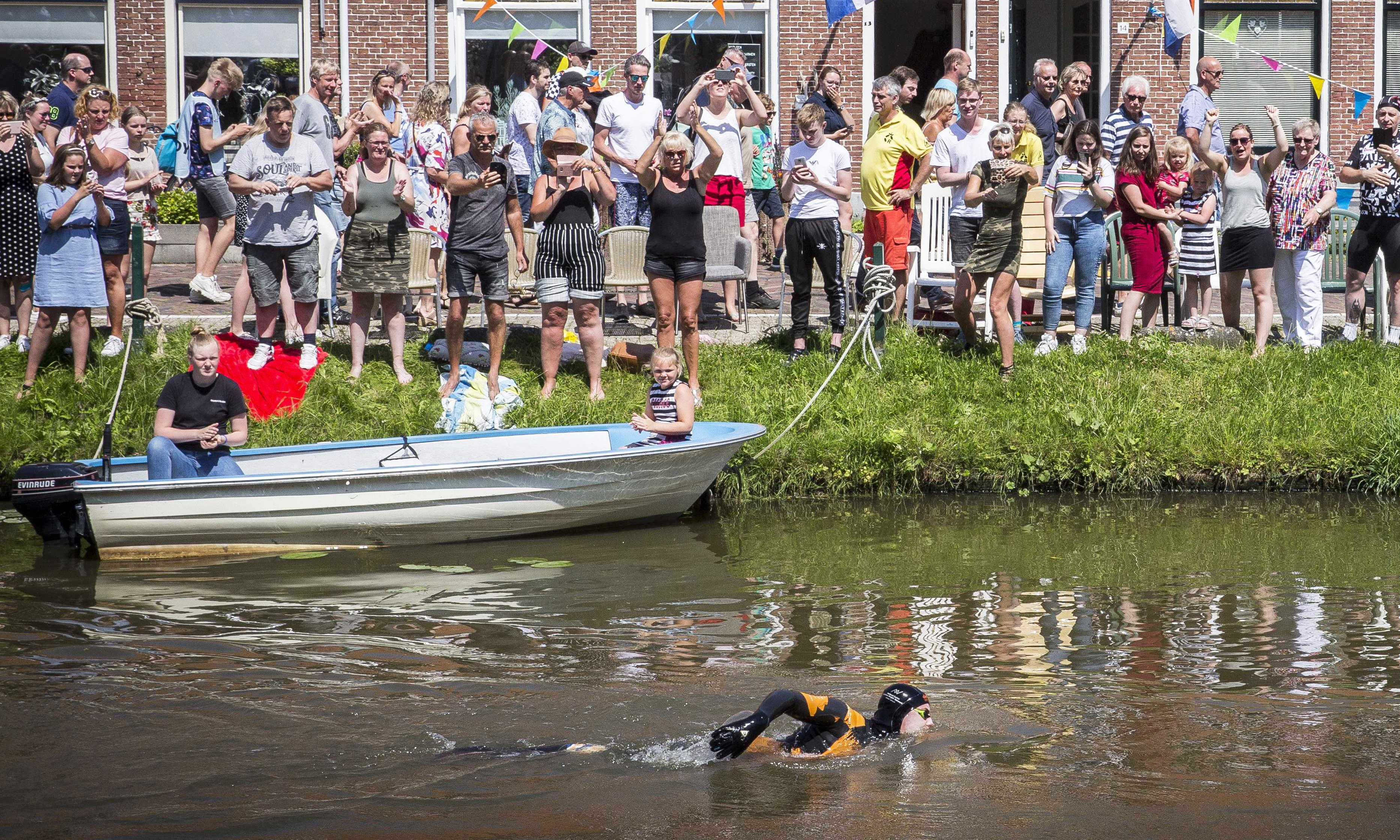 Dutchman swims 121-mile canal route formerly used for ice-skating race
