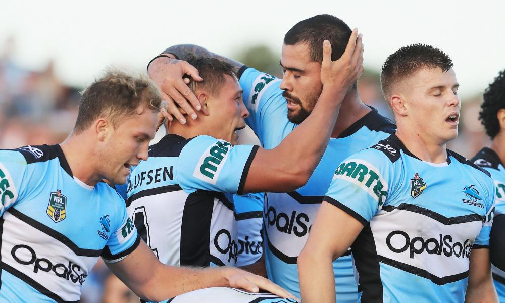 Cronulla Sharks players celebrate a try