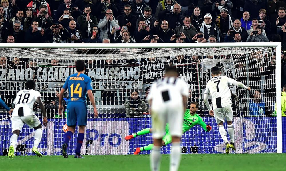 Juventus' Cristiano Ronaldo scores their third goal from the penalty spot to complete his hat-trick .