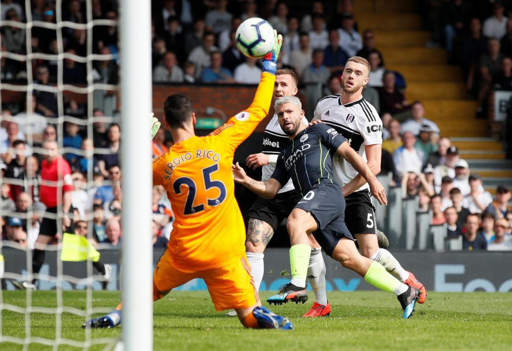 Manchester City's Sergio Aguero scores their second goal.