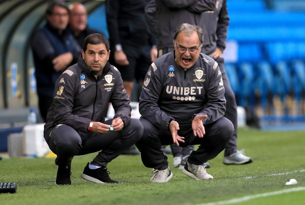 Leeds United manager Marcelo Bielsa shouts instructions from the sidelines.