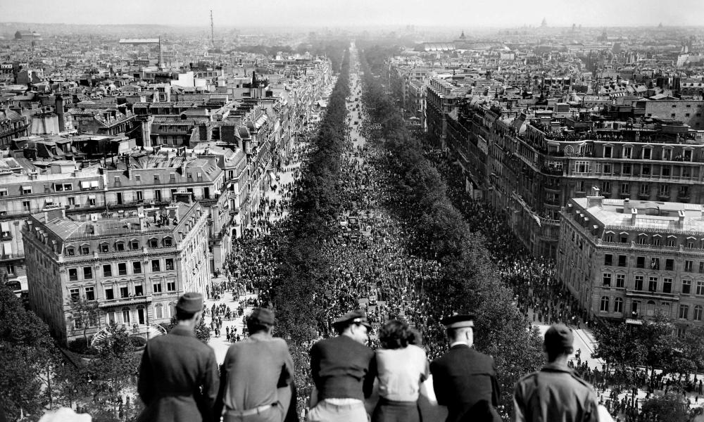 On May 8, 1945, Parisians gather on the Champs-Élysées to celebrate the German surrender in the second world war.
