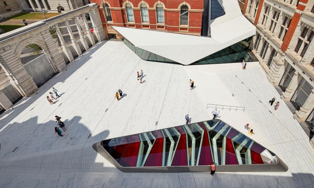 The courtyard from above, with the sloping roof of the cafe, and the roof lights of the new gallery on the other side.