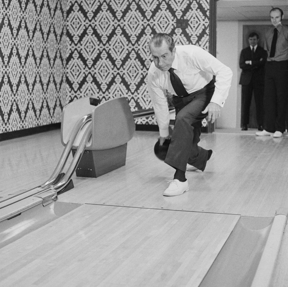 Richard Nixon displays his bowling skills.