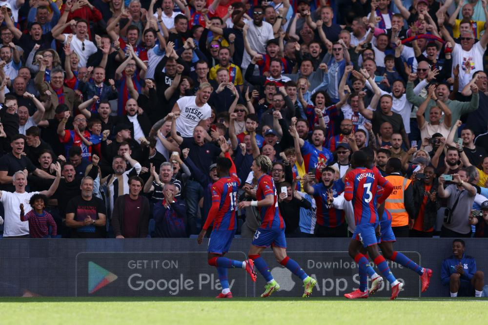 Wilfried Zaha of Crystal Palace celebrates with Conor Gallagher after scoring their side's first goal.