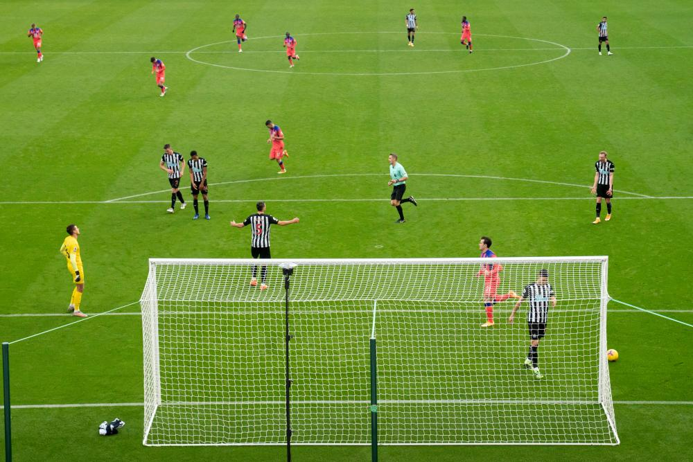 Players react after Chelsea's Tammy Abraham scores past Newcastle's goalkeeper Karl Darlow.