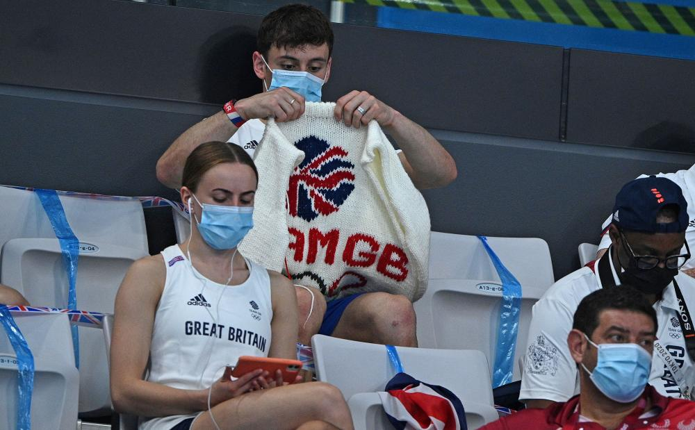 Tom Daley with one of his knits at a Tokyo 2020 diving event
