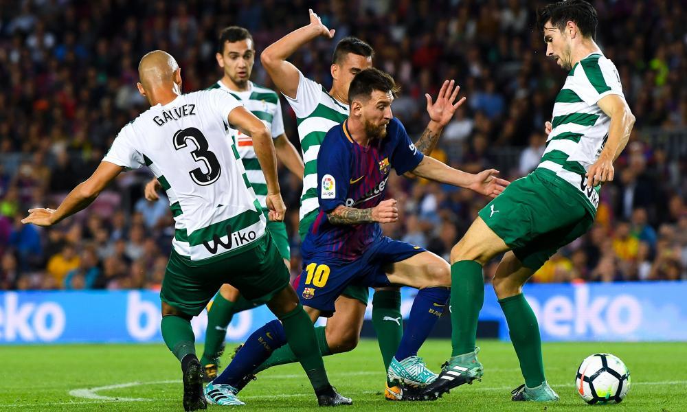 Messi dances through a crowd of Eibar players.