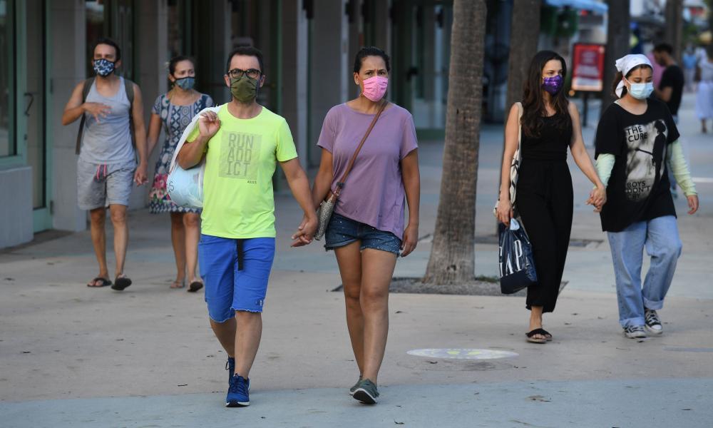 People wear masks in Miami Beach, Florida, 24 July 2020.