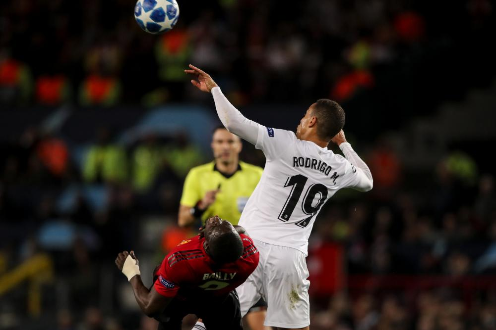 Eric Bailly is caught by a stray arm from Rodrigo.