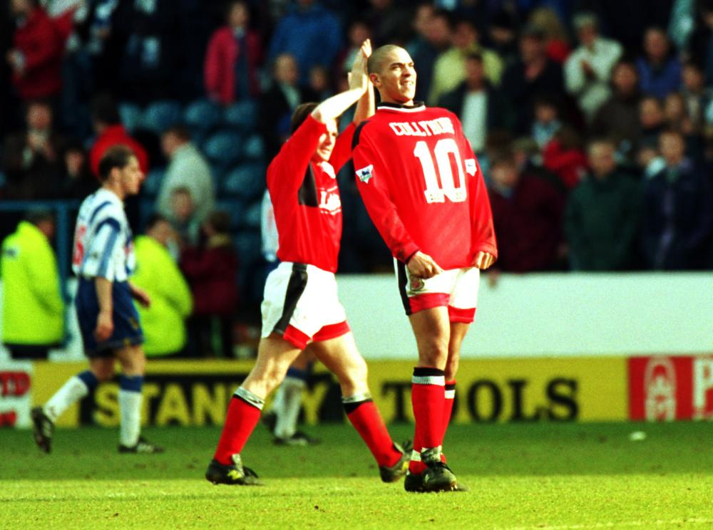 Stan Collymore celebrates after scoring for Forest.