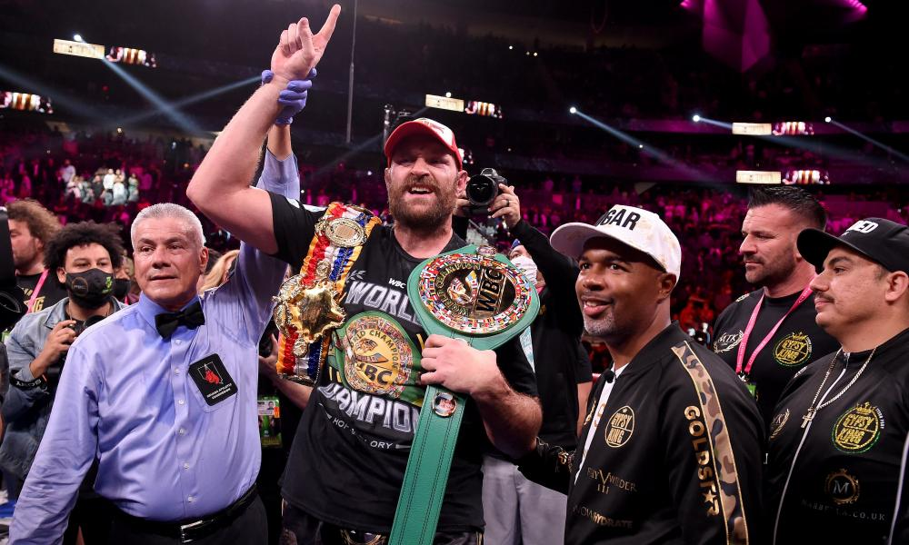 Tyson Fury stands victorious after his dramatic 11th-round knockout win.