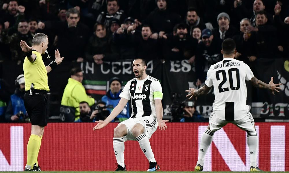 Come on Ref! Juventus' Giorgio Chiellini (centre) and Joao Cancelo (R) contest referee Bjoern Kuipers' decision to not allow Chiellini's goal.