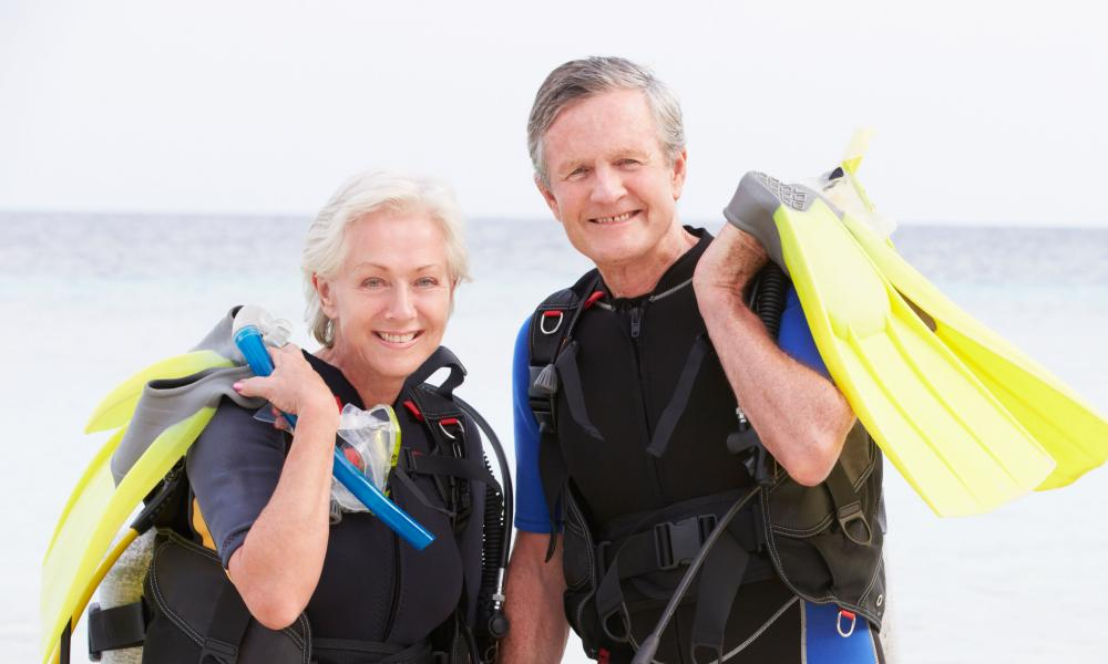Senior Couple With Scuba Diving Equipment