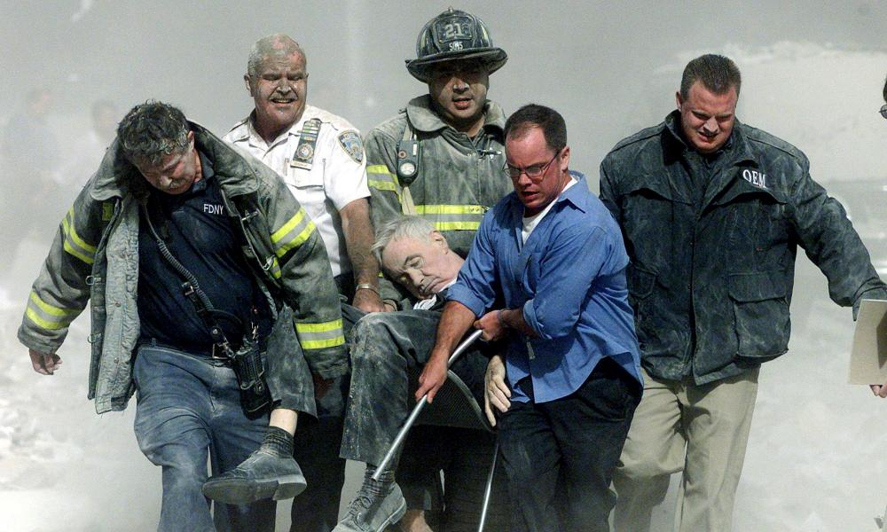Rescue workers carry Father Mychal Judge, the fire department chaplain, from one of the World Trade Center towers on September 11, 2001.