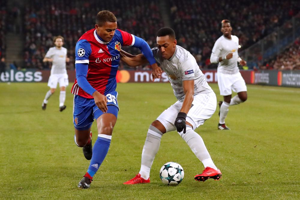 Manchester United's Anthony Martial in action with Basel's Manuel Akanji.