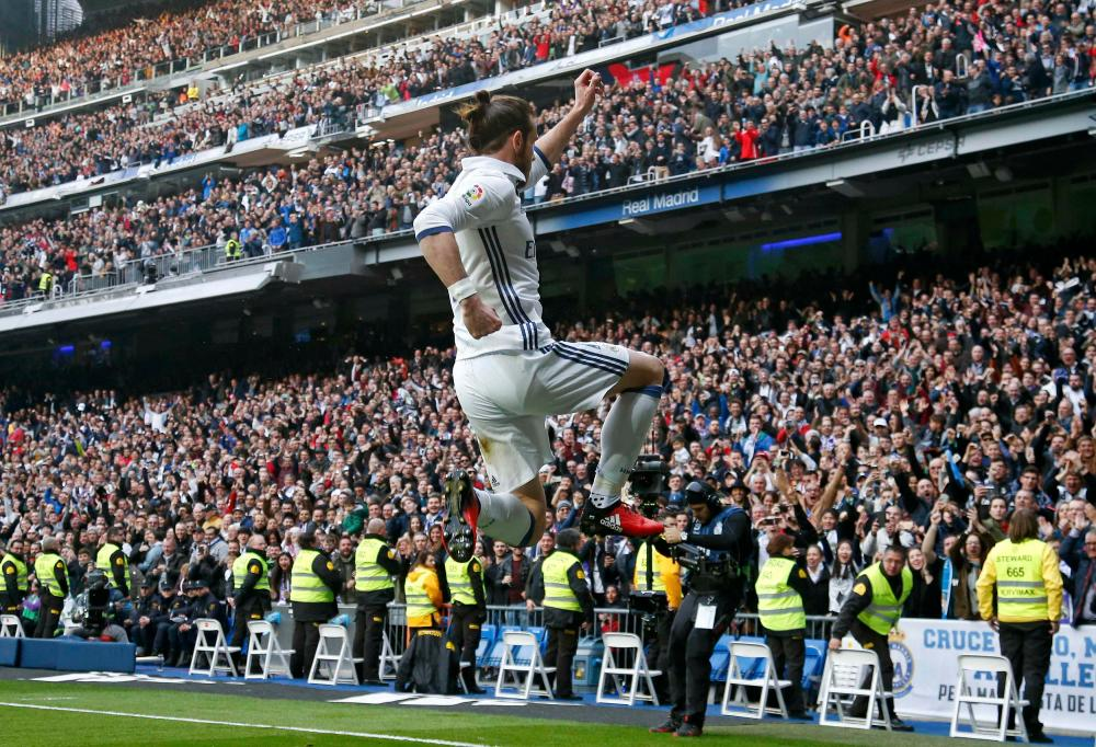 Gareth Bale celebrates after scoring the second goal.