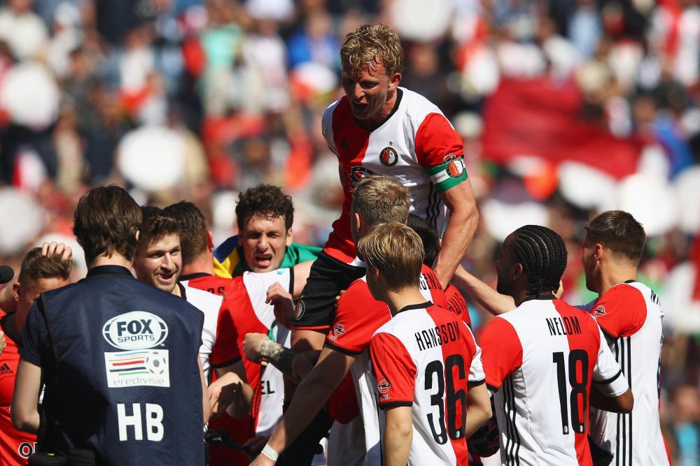 Feyenoord captainDirk Kuyt celebrates with team mates after winning the Dutch Eredivisie at De Kuip or Stadion Feijenoord