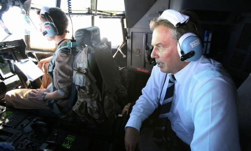 Tony Blair travelling in the cockpit of a C130 Hercules during the journey from Baghdad to Basra in Iraq.