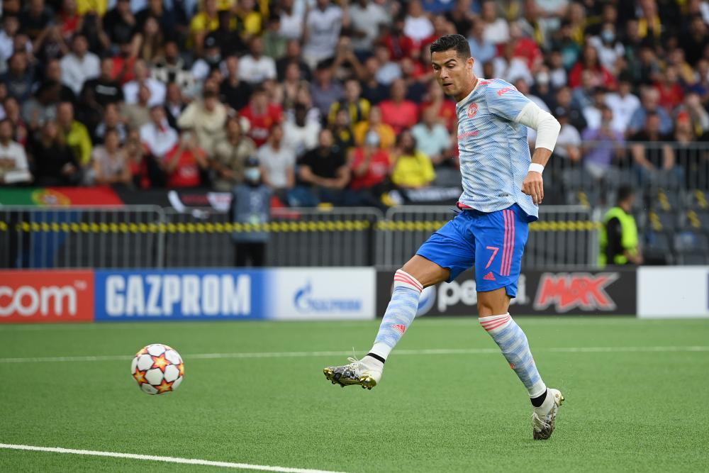 Cristiano Ronaldo slots the ball home to give Manchester United the lead.