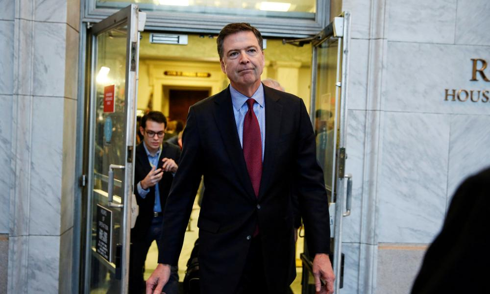 In a 2018 photo, former FBI Director Comey departs after giving a private deposition to the House Judiciary and House Government and Oversight committees on Capitol Hill in Washington.