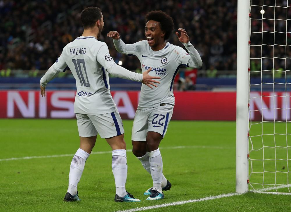 Chelsea's Willian celebrates scoring their second goal with Eden Hazard.