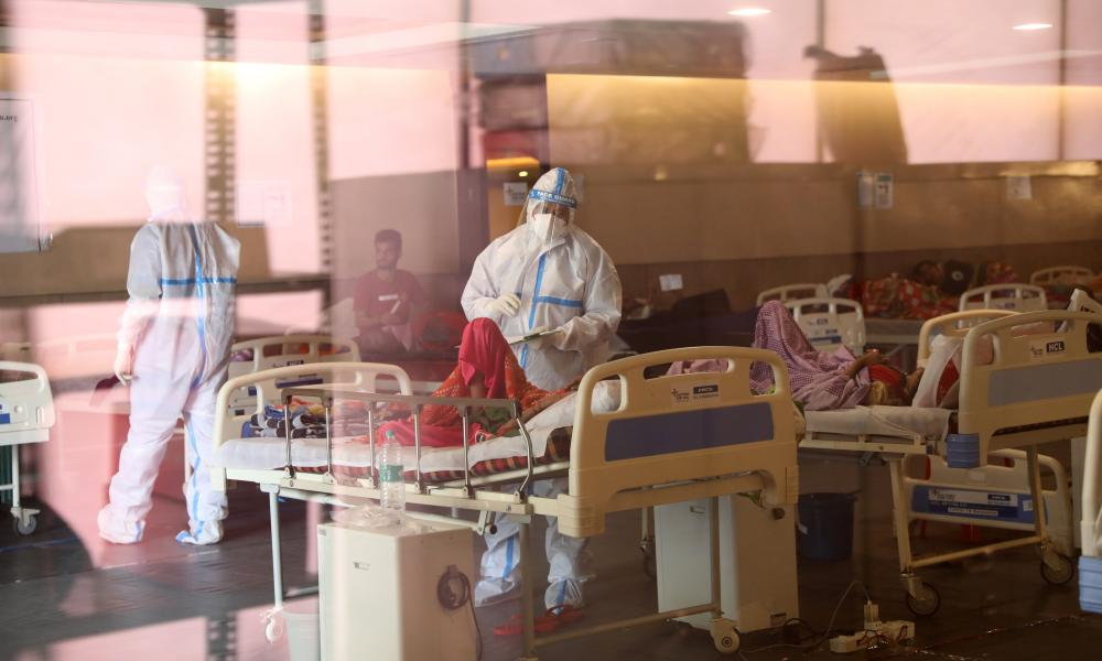 Indian doctors examine patients in a Covid care centre in Delhi, April 2021.