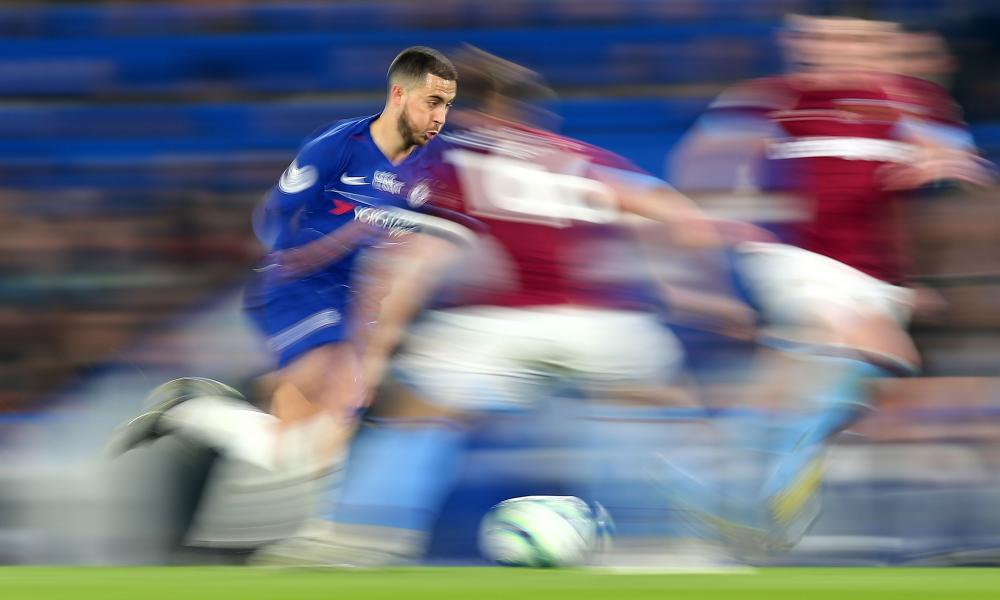 Eden Hazard charges between West Ham defenders before firing home to score the first of his two goals in Chelsea's 2-0 win at Stamford Bridge.