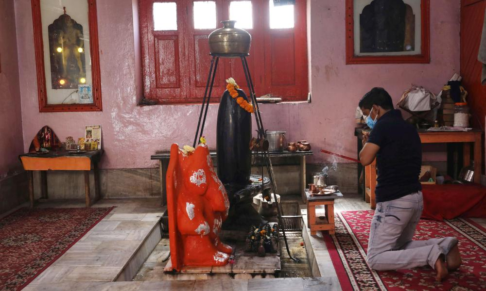 A Kashmiri Pandit (Hindu) man prays during special prayers on the occasion of the Hindu festival Ganesha Chaturthi at a temple in Srinagar, the summer capital of Indian Kashmir, 10 September 2021